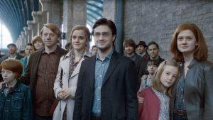 """SUNDAY CALENDAR AUGUST 7, 2011. DO NOT USE PRIOR TO PUBLICATION ******************** (L-r) RYAN TURNER as Hugo Weasley (19 years later), RUPERT GRINT as Ron Weasley, EMMA WATSON as Hermione Granger, DANIEL RADCLIFFE as Harry Potter, DAPHNE DE BEISTEGUI as Lily Potter (19 years later) and BONNIE WRIGHT as Ginny Weasley in Warner Bros. Pictures' fantasy adventure movie """"HARRY POTTER AND THE DEATHLY HALLOWS - PART 2,"""" a Warner Bros. Pictures release. Photo courtesy of Warner Bros. Pictures"""