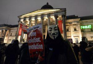 epa05012727 Protesters take part in the 'Million Mask' demonstration in Trafalgar Square, London, Britain, 05 November 2015. The demonstration takes place on 'Bonfire Night' the anniversary of the capture of Guy Fawkes, during his attempt to blow up the Houses of Parliament in 1605. EPA/HANNAH MCKAY